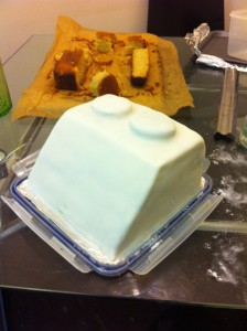 Lego cake covered in white fondant layer